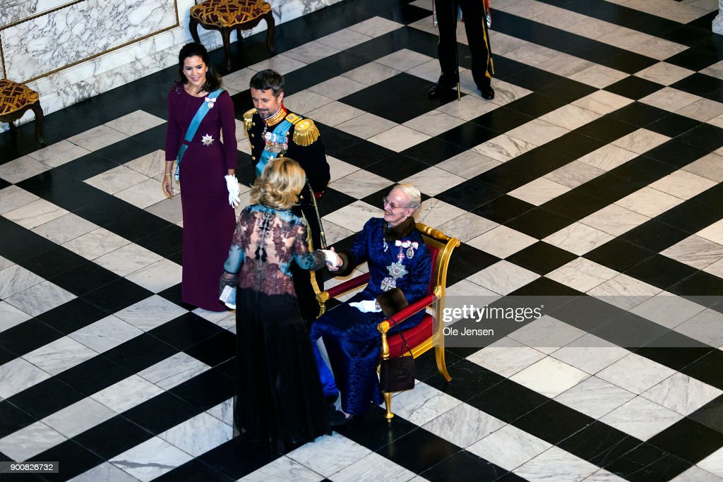 US Ambassador to Denmark Carla Sands shake hands with Queen Margrethe of Denmark (sitting) during the Queen's Traditional New Year's Banquet for foreign diplomats hosted by the Queen at Christiansborg Palace on January 3, 2018 in Copenhagen, Denmark.