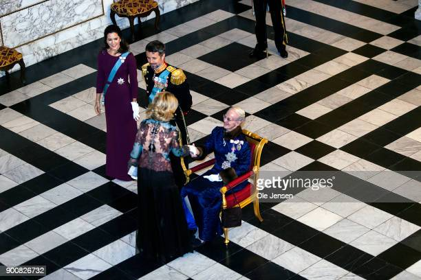 Ambassador to Denmark Carla Sands shake hands with Queen Margrethe of Denmark during the Queen's Traditional New Year's Banquet for foreign diplomats...
