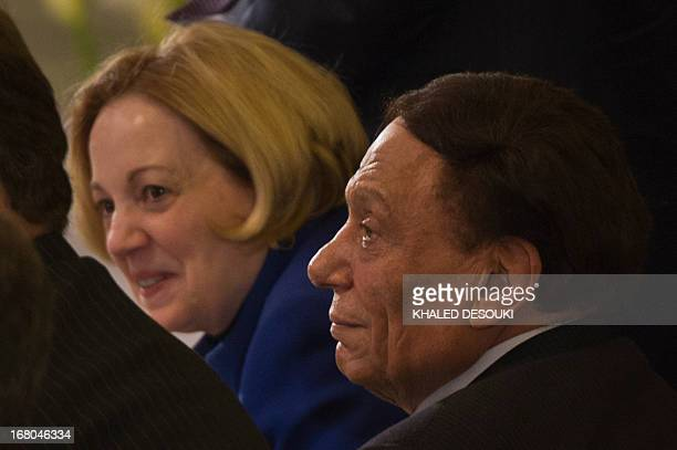 US ambassador to Egypt Anne Patterson and Egyptian comedian Adel Imam attend the Easter mass led by Coptic Pope Tawadros II at the Saint Mark's...