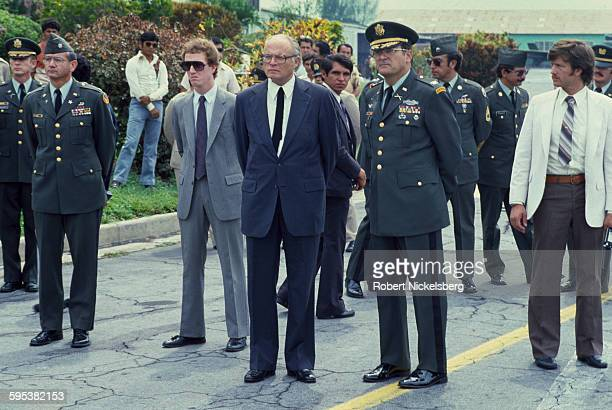 US Ambassador to El Salvador Deane R Hinton and military advisor Colonel John D Waghelstein along with others stand at Ilopongo Airport San Salvador...