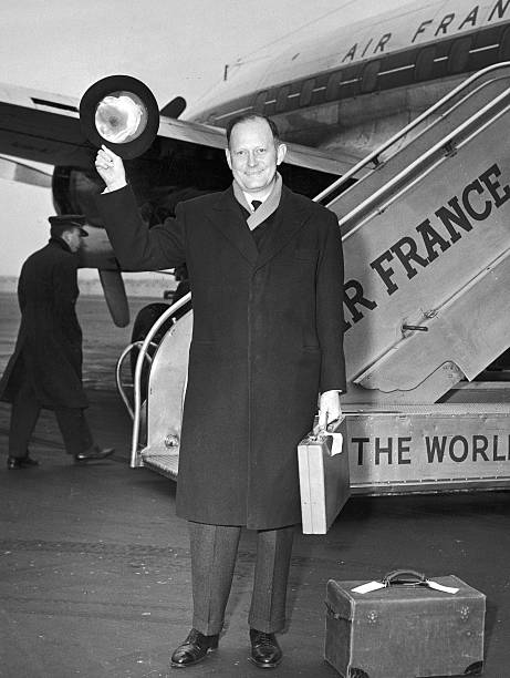 Douglas Dillon Waves Hat At Airport, NYC, c. 1961.