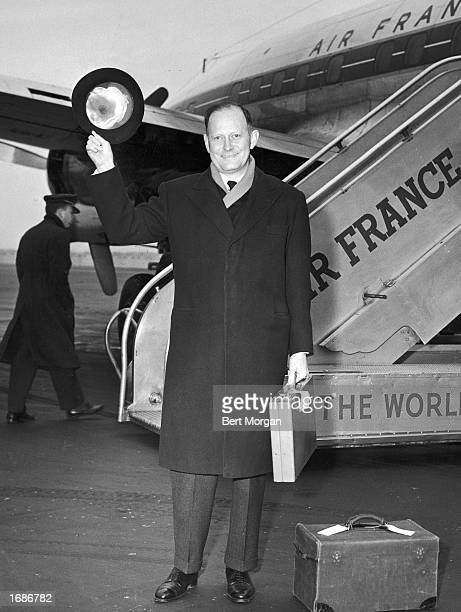US ambassador to France C Douglas Dillon waves his hat in front of an Air France plane aftyer his return from Paris France circa 1961