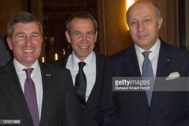 US Ambassador to France Charles H Rivkin American artist Jeff Koons and French Foreign Minister Laurent Fabius attend the annual gala evening of the...