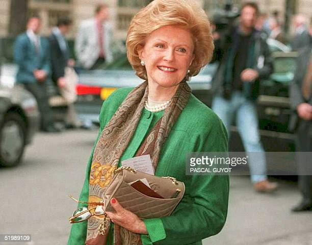 US ambassador to France Pamela Harriman smiles as she arrives for a meeting of 14 NATO and EU countries to discuss ways of protecting UN peacekeepers...