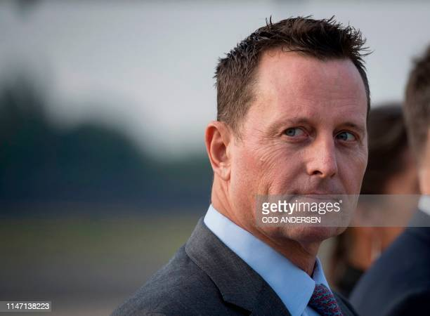 US ambassador to Germany Richard Grenell awaits the arrival of US Secretary of State Mike Pompeo at Tegel airport in Berlin on May 31 2019 The US top...