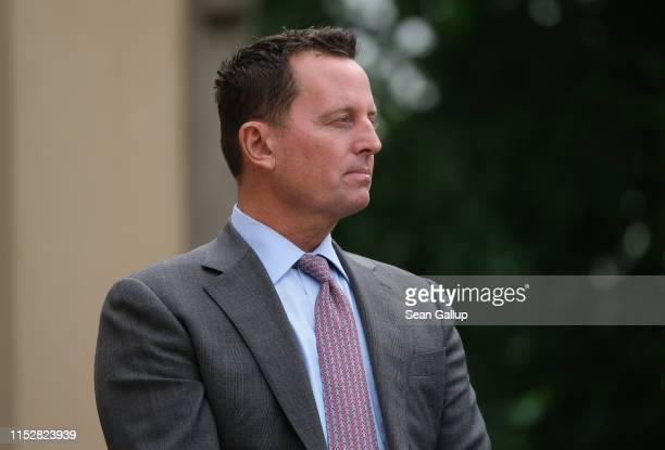 Ambassador to Germany Richard Grenell looks on as U.S. Secretary of State Mike Pompeo and German Foreign Minister Heiko Maas speak to the media...