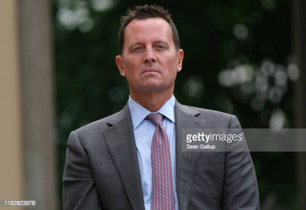 S Ambassador to Germany Richard Grenell looks on as US Secretary of State Mike Pompeo and German Foreign Minister Heiko Maas speak to the media...