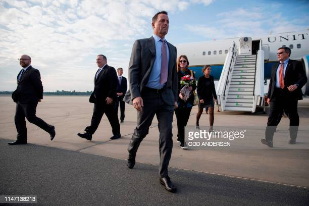 US ambassador to Germany Richard Grenell walks to his vehicle after greeting US Secretary of State Mike Pompeo at Tegel airport in Berlin on May 31...