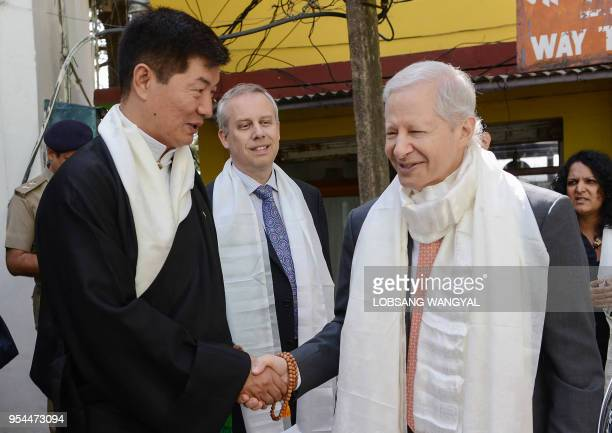 US Ambassador to India Kenneth Juster shakes hands with President of Central Tibetan Administration Lobsang Sangay outside the Dalai Lama's residence...