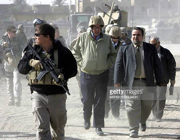 US ambassador to Iraq John Negroponte and Iraqi Minister of Industry Hajem alHassani visit the restive city of Fallujah 50 kms west of Baghdad 27...