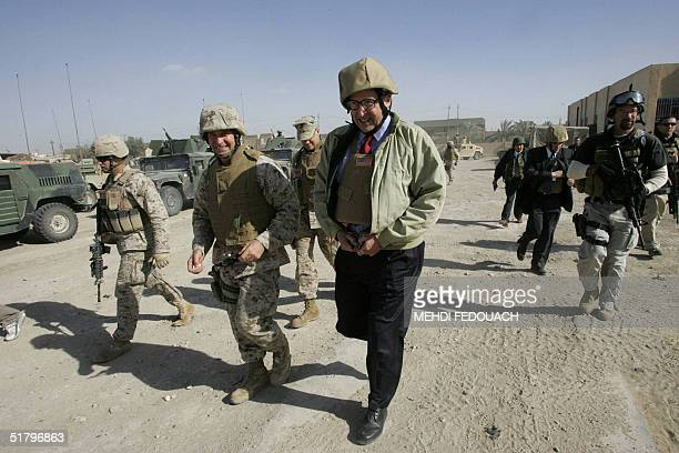 US ambassador to Iraq John Negroponte visits the restive city of Fallujah 50 kms west of Baghdad 27 November 2004 Negroponte stressed that January's...