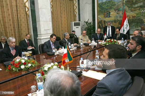 S Ambassador to Iraq Ryan Crocker left Iranian ambassador Hassan Kazemi Qomi right and Iraqi Prime Minister Nouri alMaliki top center attend a...