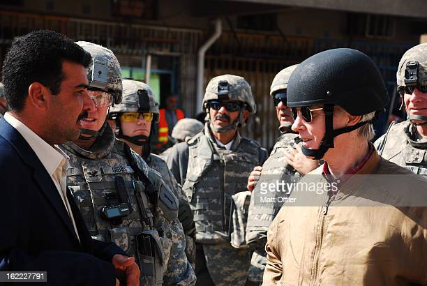 Ambassador to Iraq, Ryan Crocker, speaks with local leader, Dr. Moayad. Prior to the war, Dr. Moayad additionally worked as Saddam's cardiologist.