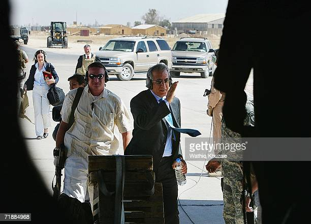 Ambassador to Iraq Zalmay Khalilzad arrives to a handover ceremony of the responsibility of much of northern Iraq from US 101st Airborne Division to...