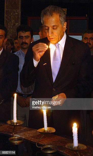 S Ambassador to Iraq Zalmay Khalilzad lights a candle August 3 2005 during a visit to Halabja museum in Halabja Iraq Mr Khalilzad paid a visit to the...