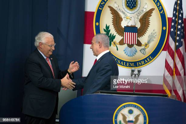 US ambassador to Israel David Friedman and Israel's Prime Minister Benjamin Netanyahu shake hands on stage during the opening of the US embassy in...