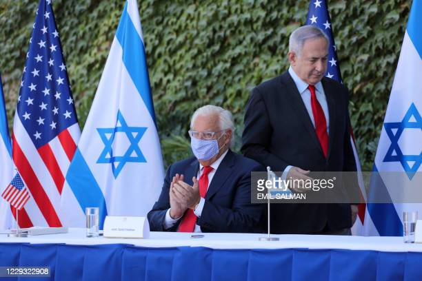 Ambassador to Israel David Friedman claps after the speech of Israeli Prime Minister Benjamin Netanyahu during the signing of an extension of the...