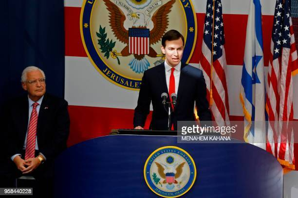 TOPSHOT US ambassador to Israel David Friedman listens as Senior White House Advisor Jared Kushner delivers a speech during the opening of the US...