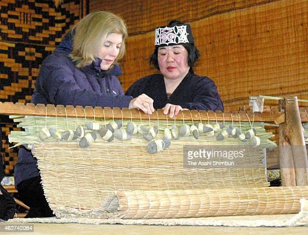 US Ambassador to Japan Caroline Kennedy tries to make Ainu straw mat during her visit at Aimu Museum Poroto Kotan on February 3 2015 in Shiraoi...