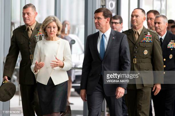 US Ambassador to NATO Kay Bailey Hutchison speaks with acting US Secretary for Defense Mark Esper upon their arrival for a meeting of NATO defense...