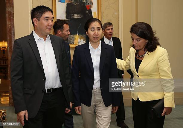 US Ambassador to Qatar Dana Shell Smith talks with Grace and Matthew Huang a US couple who were sentenced to three years in jail in Qatar in April...