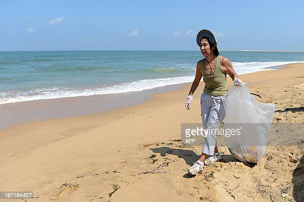 US Ambassador to Sri Lanka Michele Sison looks for rubbish along the coast of Colombo on April 22 on World Earth Day Some one billion people in...