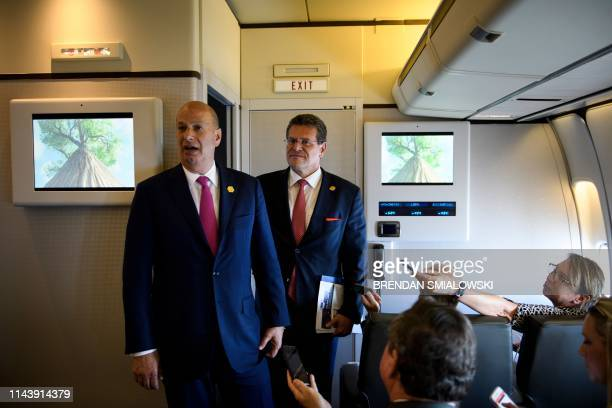 US Ambassador to the EU Gordon Sondland and European Commission Vice President Maros Sefcovic talk with to reporters aboard Air Force One May 14 in...
