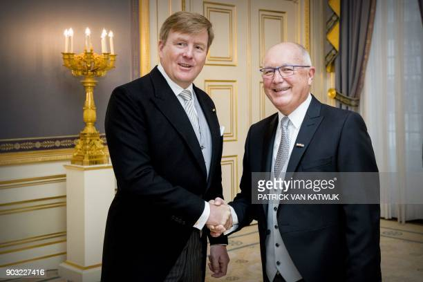 Ambassador to The Netherlands, Peter Hoekstra , shakes hands with Dutch King Willem-Alexander after presenting his credentials during a ceremony at...