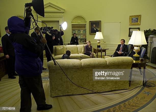 Ambassador to the UN John Bolton sits in the Oval Office of the White House with his wife Gretchen Bolton after a meeting with US President George W...
