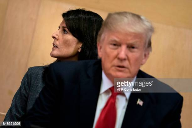 US Ambassador to the UN Nikki Haley and US President Donald Trump wait for a a meeting on United Nations Reform at UN headquarters in New York on...