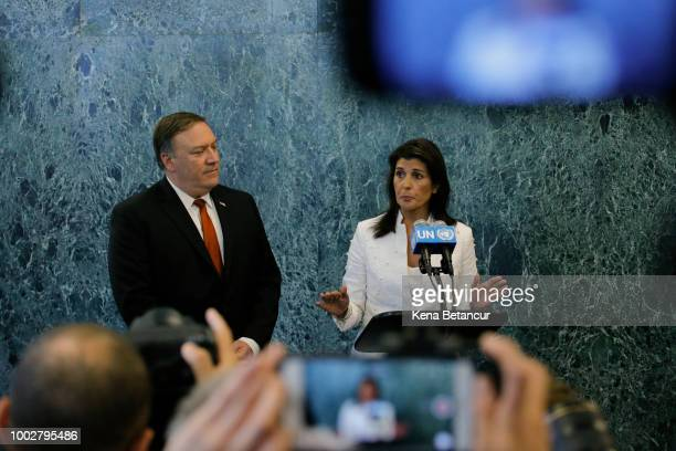 Ambassador to the UN Nikki Haley speaks to members of the media next to US Secretary of State Mike Pompeo at the UN head quarters on July 20 2018 in...