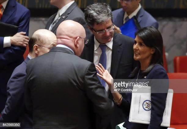 US Ambassador to the UN Nikki Haley speaks to Russian Ambassador Vasily Nebenzya Chinese Ambassador Liu Jieyi and French Ambassador Francois Delattre...