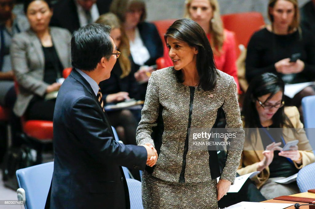 US Ambassador to the UN Nikki Haley (L), speaks with South Korean Ambassador to the UN Cho Tae-yul before a United Nations Security Council emergency meeting over the launch of another ballistic missile by North Korea on November 29, 2017, at UN Headquarters in New York. /