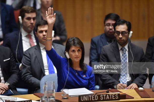 US Ambassador to the UN Nikki Haley votes during a UN Security Council meeting at the United Nations Headquarters in New York on April 14 2018 Russia...