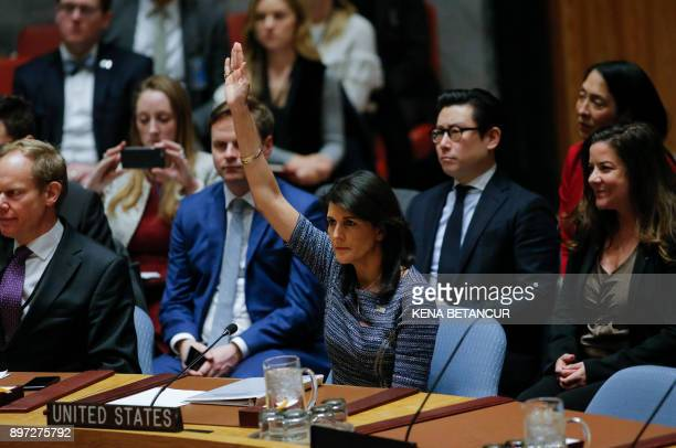 US Ambassador to the UN Nikki Haley votes on new sanctions on North Korea during a Security Council meeting on December 22 at UN Headquarters in New...