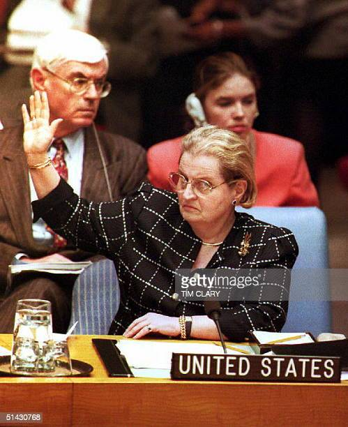 S Ambassador to the United Nations Madeleine Albright raises her hand during a unanimous UN Security Council vote 06 May 1993 to declare Sarajevo and...