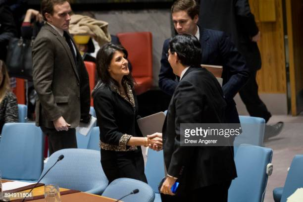 Ambassador to the United Nations Nikki Haley greets Israeli ambassador to the United Nations Danny Danon at the conclusion of a U.N. Security Council...