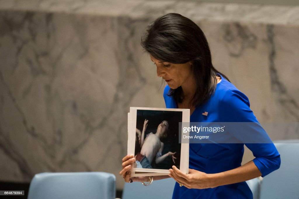 U.S. Ambassador to the United Nations Nikki Haley holds a photo of a victim of the Syrian chemical attack during a meeting of the United Nations Security Council at U.N. headquarters, April 5, 2017 in New York City. The Security Council is holding emergency talks on Wednesday following the worst use of chemical weapons in Syria since the Ghouta attack in 2013.