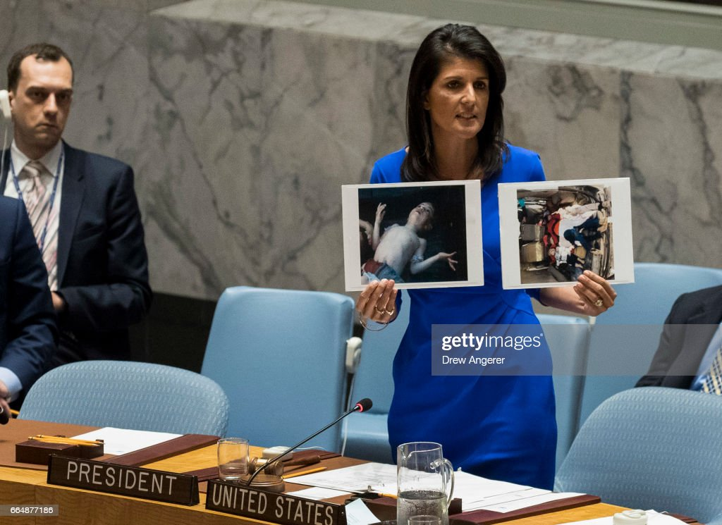 U.S. Ambassador to the United Nations Nikki Haley holds up photos of victims of the Syrian chemical attack during a meeting of the United Nations Security Council at U.N. headquarters, April 5, 2017 in New York City. The Security Council is holding emergency talks on Wednesday following the worst use of chemical weapons in Syria since the Ghouta attack in 2013.