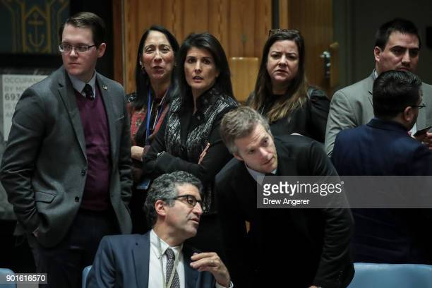 S Ambassador to the United Nations Nikki Haley huddles with members of the US delegation before the start of a UN Security Council meeting concerning...
