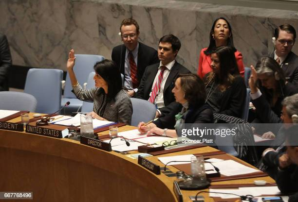 S Ambassador to the United Nations Nikki Haley joins other members of the Security Council during a vote on a draft resolution demanding that the...