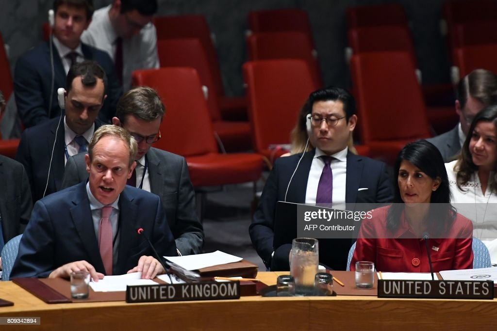 US Ambassador to the United Nations Nikki Haley (R) listens as Britain's Ambassador Matthew Rycroft (L) speaks during a Security Council meeting on North Korea at the UN headquarters in New York on July 5, 2017. The UN Security Council held an emergency meeting after North Korea said it had successfully tested its first intercontinental ballistic missile. / AFP PHOTO / Jewel SAMAD