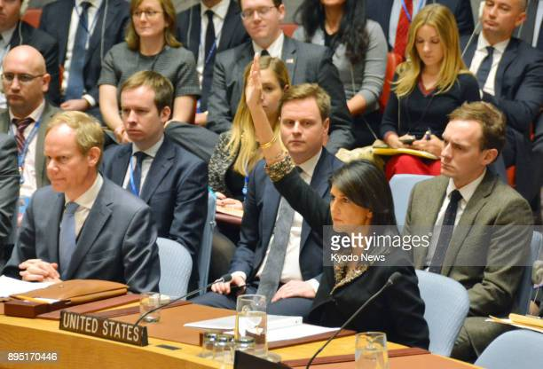US Ambassador to the United Nations Nikki Haley raises her hand during a UN Security Council meeting in New York on Dec 18 to exercise the veto over...