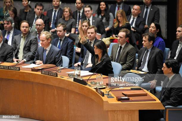 US Ambassador to the United Nations Nikki Haley raises her hand to exercise a veto during a United Nations security council meeting at the UN...