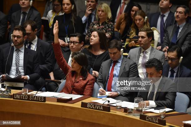 TOPSHOT US ambassador to the United Nations Nikki Haley votes against a Russiandrafted resolution Tuesday on investigating chemical weapons use in...