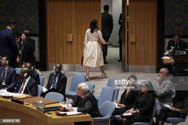 US Ambassador to the United Nations Nikki Haley walks out of the chamber as Permanent Observer of Palestine to the United Nations Riyad Mansour...