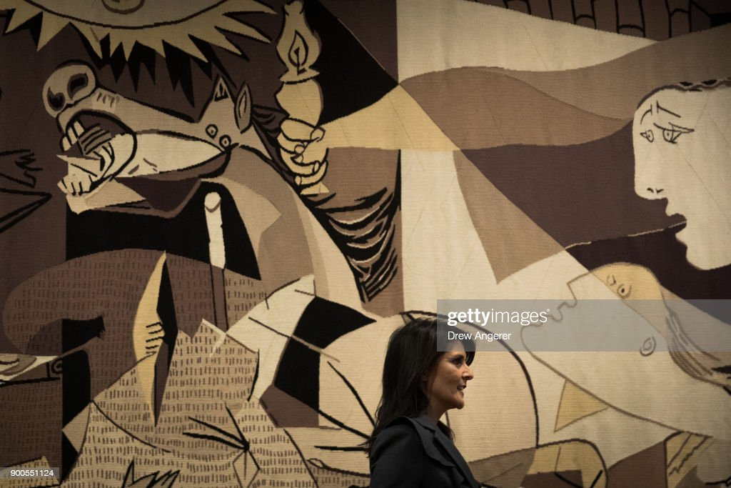 U.S. ambassador to the United Nations Nikki Haley walks past a replica of 'Guernica' by Pablo Picassoas as she arrives for a press availability at United Nations headquarters, January 2, 2018 in New York City. She discussed protests in Iran and the North Korea nuclear threat.