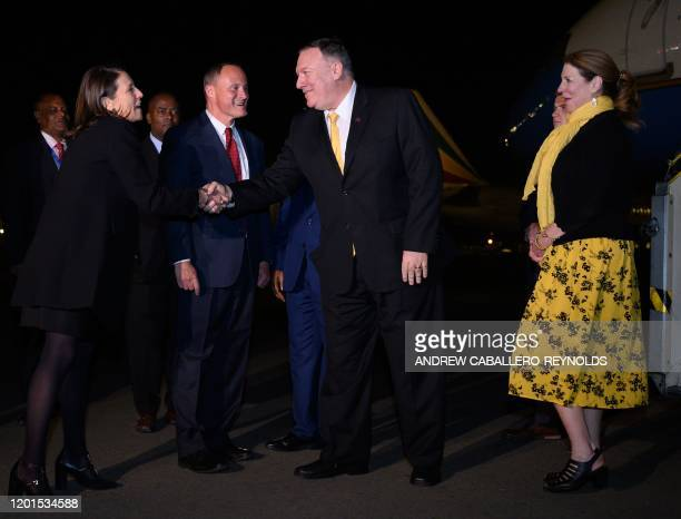 US Ambassador to the US Mission to the African Union Jessye Lapenn shakes hands with US Secretary of State Mike Pompeo as US Ambassador to Ethiopia...