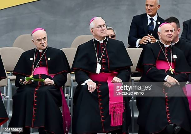 Ambassador to the Vatican Carlo Maria Vigano and Vincenzo Paglia listen to Pope Francis speaking at Independence Hall in Philadelphia on September 26...
