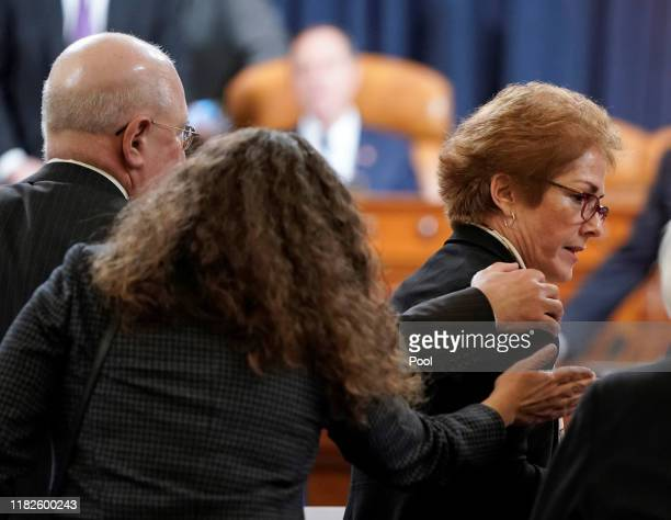 S Ambassador to Ukraine Marie Yovanovitch is congratulated by supporters after testifying before the House Intelligence Committee in the Longworth...
